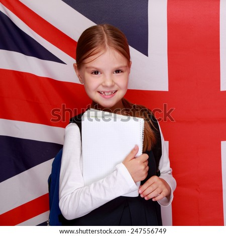 British school girl on background of the flag of England - stock photo