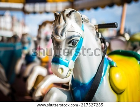 British seaside fairground horses on a carousel or merry-go-round.