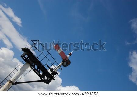 British semaphore home signal on a gantry set against a blue sky - stock photo