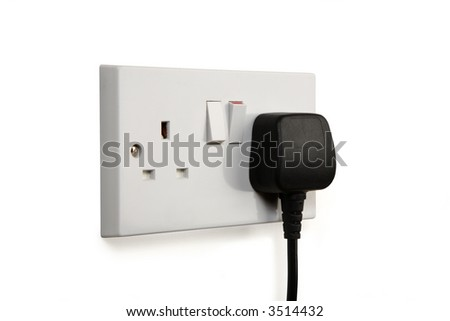 British socket and black plug. Socket turned on.