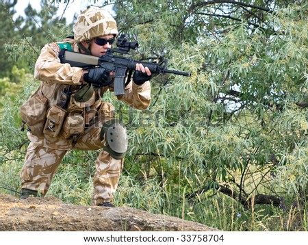 British soldier in camouflage uniform in action - stock photo