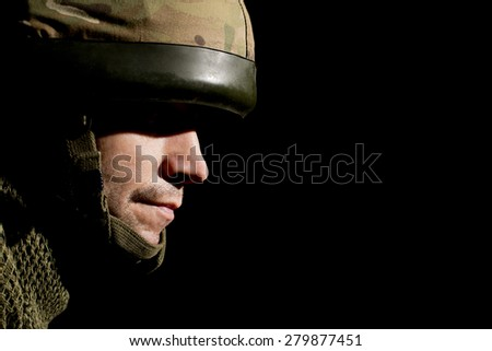 British Soldier With Face In Shadow - stock photo