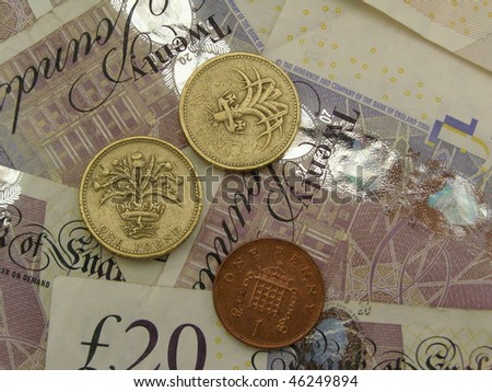 British Sterling Pound (GBP) coins and banknotes - stock photo