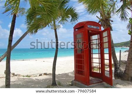 british telephone box on beach in antigua - stock photo