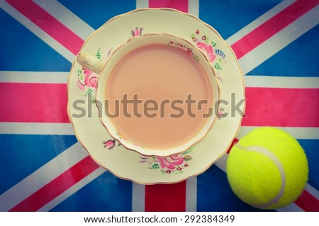 British Tennis - A cup of Tea on a Union Jack flag with a tennis ball - stock photo