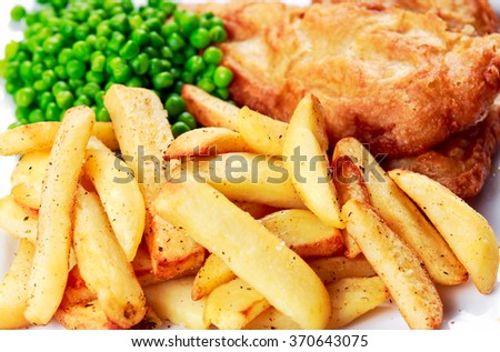 British Traditional Fish and chips with peas - stock photo