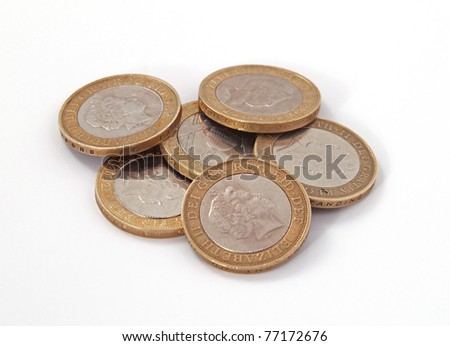British, UK, two pound coins on a plain white background. - stock photo