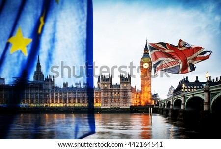 British union jack flag and Big Ben Clock Tower and Parliament house at city of westminster in the background, blurred EU flag - UK votes to leave the EU - stock photo
