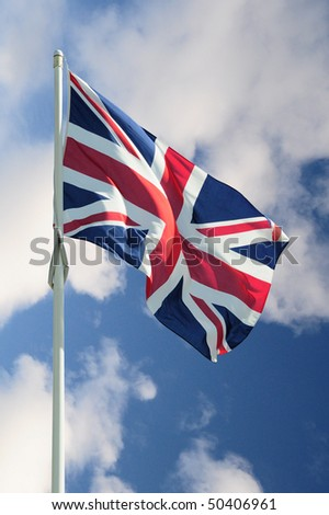 British Union Jack flag on a cloudly sky
