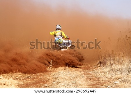 BRITS, SOUTH AFRICA - July 11:  Africa-Offroad Racing Rally,  on July 11, 2015 at Koster, North West Province, South Africa.  Quad Bike kicking up trail of dust on sand track during rally race.