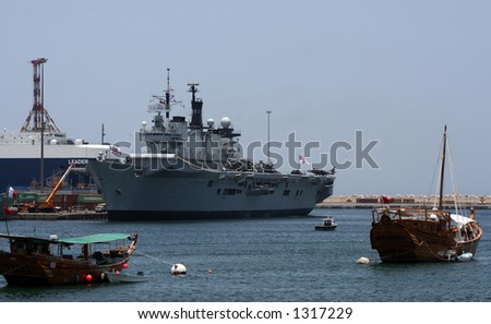 Britsh Navy aircraft carrier HMS Illustrious docked in Muscat in Oman. - stock photo