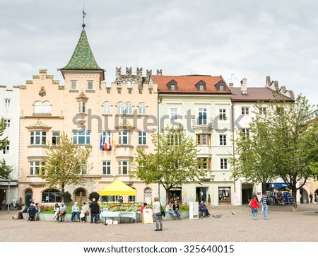 BRIXEN, ITALY - SEPTEMBER 22: Tourists at the Piazza Duomo in Brixen, Italy on September 22, 2015. Brixen is one of the oldest towns of Tyrol. Foto taken from Piazza Duomo with view to the town hall. - stock photo