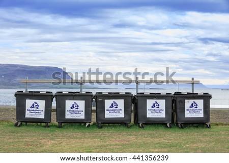 BRJANSLAEKUR,ICELAND - JUNE 12, 2016: The big metal bins are on beside coastal road in summer. - stock photo