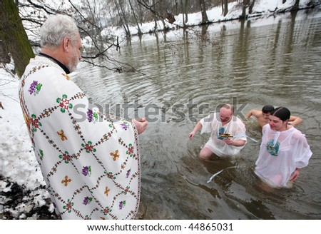 BRNO, CZECH REP - JANUARY 19: Orthodox Christians celebrate Epiphany by the river Svratka on January 19, 2010 in Brno, Czech Rep.