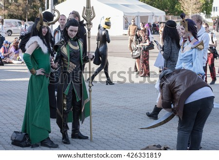 BRNO, CZECH REPUBLIC - APRIL 30, 2016: Cosplayers dressed as the character Lady Loki and Loki  from Marvel movie pose at Animefest, anime and manga convention on April 30, 2016 Brno Czech Republic