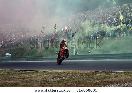 BRNO - CZECH REPUBLIC, AUGUST 16: Spanish Honda rider Marc Marquez at 2015 MotoGP of Czech Republic at Brno circuit on August 16, 2015 - stock photo