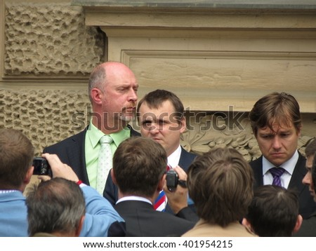 BRNO, CZECH REPUBLIC - CIRCA MAY 2013: unidentified politician surrounded by photographers in front of the Constitutional Court - stock photo