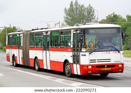 BRNO, CZECH REPUBLIC - JULY 22, 2014: Articulated city bus Karosa B941E at the city street. - stock photo