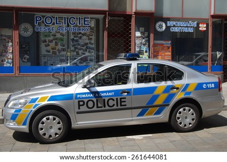 Brno, Czech Republic - July 20, 2014: Municipal police car, Skoda Octavia, parked on a city street in front of a local police station. Nobody in vehicle. - stock photo