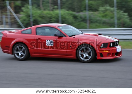 BRNO,CZECH REPUBLIC-MAY 16. Driver no.509 in car Ford Mustang during the race at International meeting of sport cars,May 16, 2009 in Brno,Czech republic - stock photo