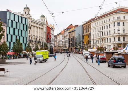 BRNO, CZECH - SEPTEMBER 25, 2015: people on Rasinova street in Brno city in morning. Brno is the second largest city in the Czech by population and area, the largest Moravian city, capital of Moravia - stock photo