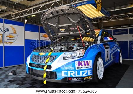 BRNO - JUNE 19: Car of Chevrolet team - Chevrolet Cruze in paddock in FIA WTCC, June 19, 2011 in Brno, Czech republic - stock photo