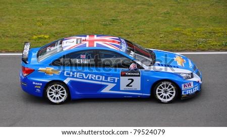 BRNO - JUNE 19: Driver of Chevrolet team Robert Huff the race in FIA WTCC, June 19, 2011 in Brno, Czech republic - stock photo