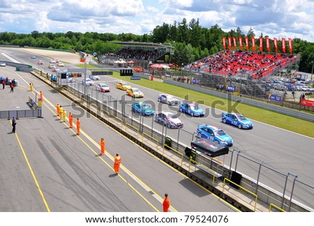 BRNO - JUNE 19: Start of the race in FIA WTCC, June 19, 2011 in Brno, Czech republic - stock photo