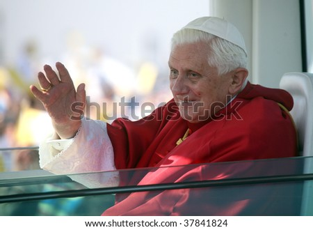 BRNO - SEPT 27: Holy father Pope Benedict XVI gestures as he greets about 120,000 pilgrims from central Europe as he travels in the Pope Mobile on mass on September 27, 2009 in Brno, Czech Republic.