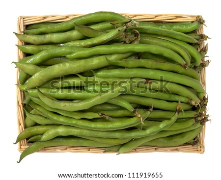 Broad beans in the basket - stock photo