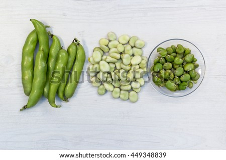 Broad beans in triple form :  pods, hulled  beans and cooked beans, top view - stock photo