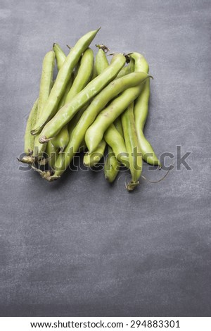 Broad Beans on a Chalkboard backdrop. With copy space. - stock photo