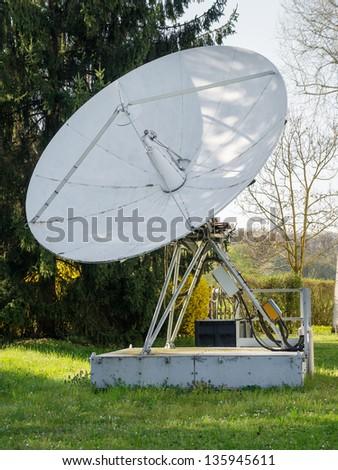 broadbrand satelite dish on television instalation - stock photo