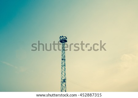 broadcast tower with old film background