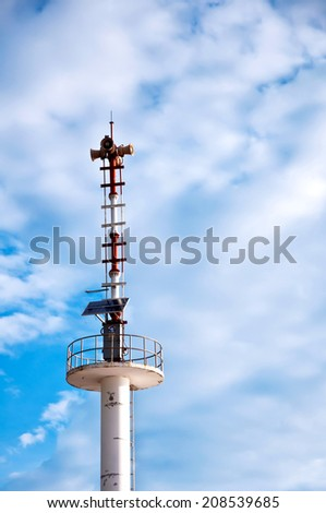 Broadcasting antenna using solar energy with blue sky - stock photo