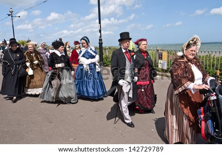 BROADSTAIRS, UK-JUNE15:  Members of the Dickens Festival Parade. This annual event celebrates Charles Dickens connection to the town where he wrote David Copperfield. June 15, 2013 Broadstairs UK - stock photo