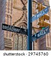 Broadway and Wall St. - stock photo