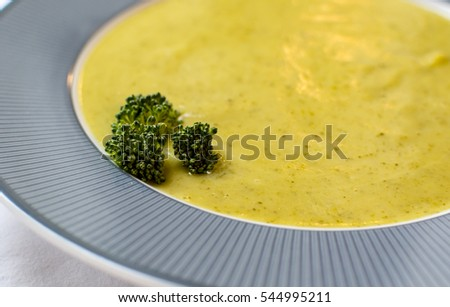 Broccoli and potato cream soup close up