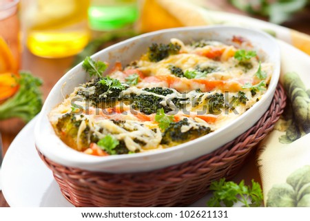 broccoli and salmon  gratin with cheese - stock photo
