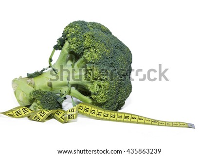 broccoli and tape measure isolated - stock photo