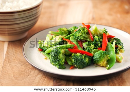 broccoli and vegetable stir fry in plate - stock photo