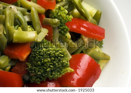 broccoli beans onions peppers in white bowl