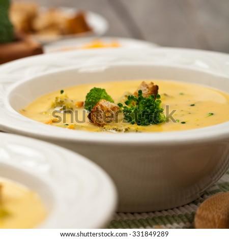 Broccoli Cheddar Soup. Selective focus. - stock photo