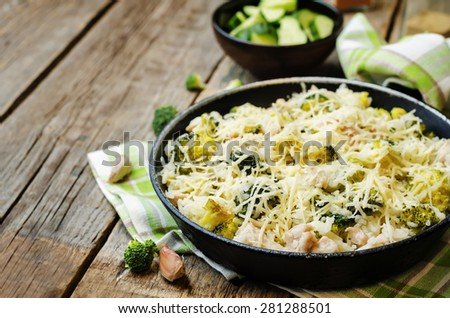 broccoli cheese chicken rice on the dark wood background. the toning. selective focus - stock photo
