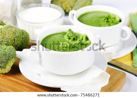 broccoli green fresh soup/in white dishes - stock photo
