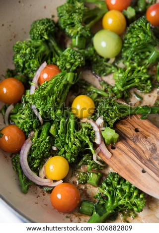 Broccoli, Heirloom Cherry Tomatoes, and Onions Sauteed in Skillet for Healthy Meal - stock photo