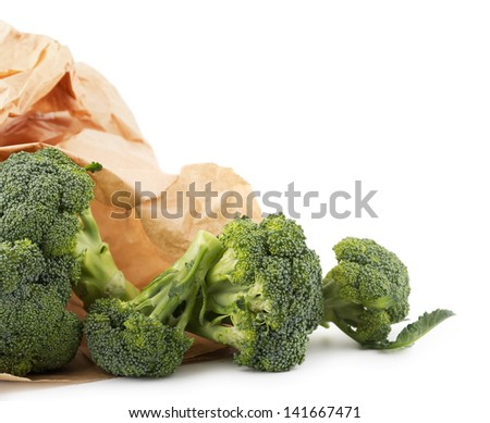 Broccoli in a paper bag, isolated - stock photo