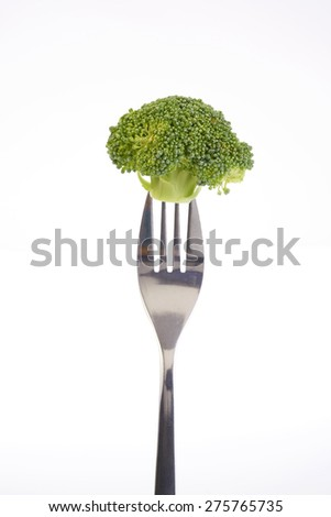 Broccoli on a fork isolated on a white background.