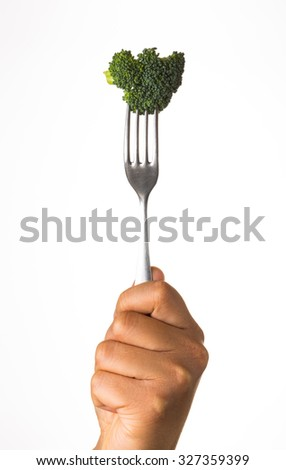 broccoli on fork isolated on white background