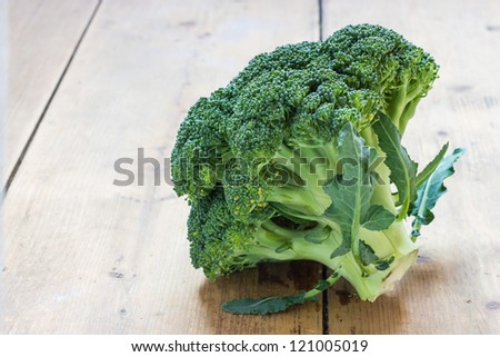 Broccoli on the table in front of a window - stock photo